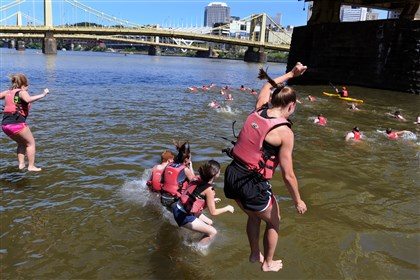 Some 25 employees of PwC Pittsburgh Some 25 employees of PwC Pittsburgh jumped into the Allegheny River Friday to raise money forAgainst Malaria Foundation.