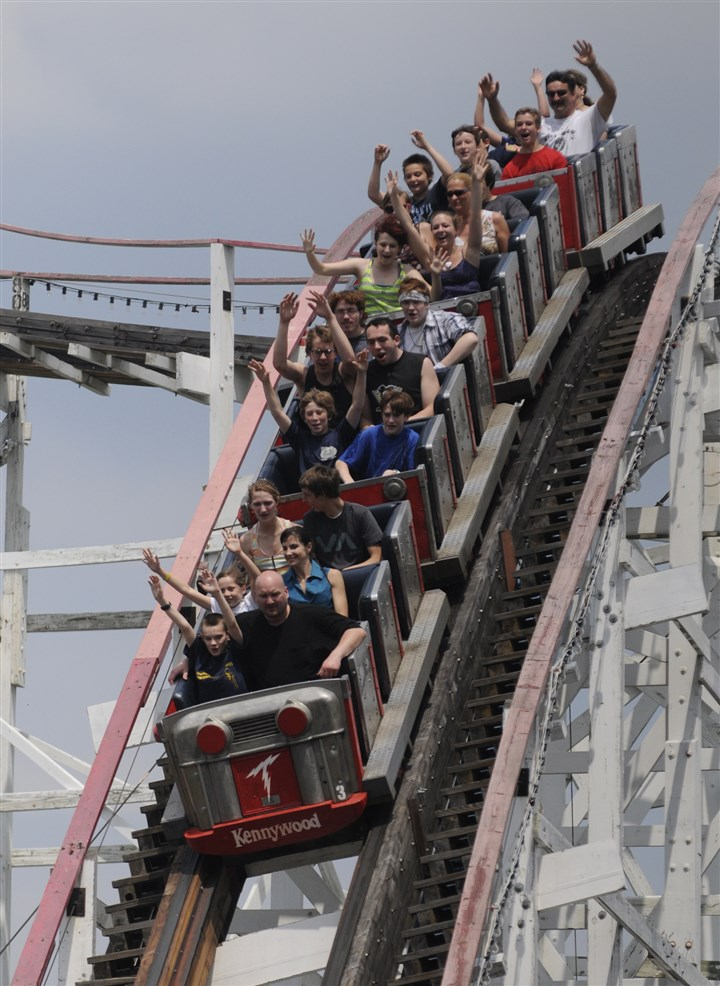 Thunderbolt Riders enjoy a ride on the Thunderbolt on opening day at Kennywood Park in 2012.