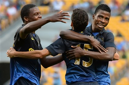 20140727pdSoccerSports06-4 Peter Diana/Post-Gazette 7/27/14 PITTSBURGH: Manchester City Jesus Navas is mobbed by teammates after scoring against AC Milan during the International Champions Cup series, at Heinz Field, Pittsburgh Pa.