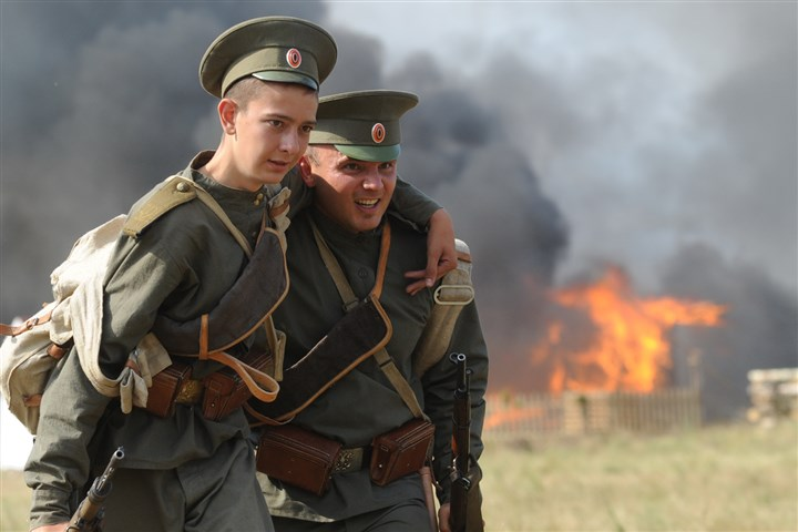 9rf00lt3-17 Actors dressed as Russian soldiers re-enact the 1914 Battle of Tannenberg Sunday in Szkotowo, Poland, marking the 100th anniversary of the beginning of World War I.