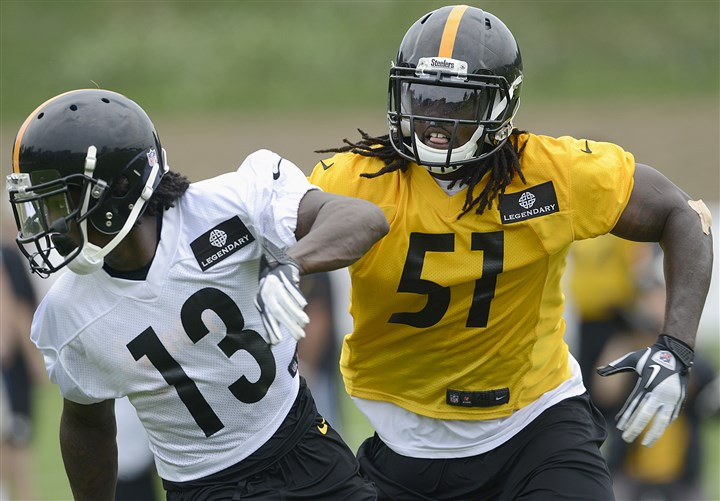 20140727radSteelersCampSpts08-4 Sean Spence covers running back Dri Archer during the Steelers training camp Sunday at Saint Vincent College in Latrobe.