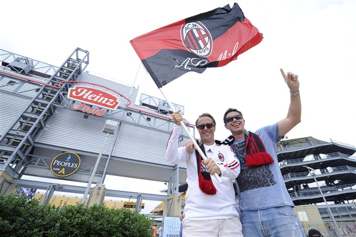 Guinness Cup Angelo Manenti, originally from Milan, and Antonio Caopdeici, originally from Lecci, Italy, both now living in Pittsburgh, wave an AC Milan flag in front of Heinz Field.
