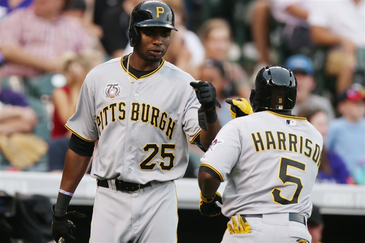 9rf00oe8 The Pirates' Gregory Polanco, left, congratulates teammate Josh Harrison Sunday on Harrison's solo home run against the Colorado Rockies in Denver.