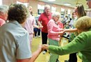 Grace Bonchuk, 98, shows everyone her moves as she joins a dance circle during a senior exercise class at the Elizabeth Seton Center in Brookline. The Sisters of Charity run the adult day care program to help give caregivers a break.