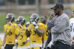 Mike Tomlin watches practice at Steelers training camp last August at St. Vincent College in Latrobe.