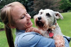 Rebecca Svetina and Casey, the 9-year-old family miniature schnauzer that made a big hit on YouTube.