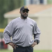 Steelers coach Mike Tomlin watching training camp drills in Latrobe last July.