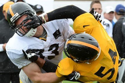 heathmiller0804 Steelers tight end Heath Miller takes down linebacker Chris Carter (right) in training camp at Saint Vincent College.