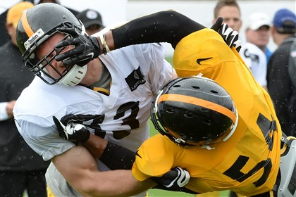 20140728pdSteelersSports07 Heath Miller takes down Chris Carter during backs on backers drill during afternoon workouts in the rain Monday at Saint Vincent College.