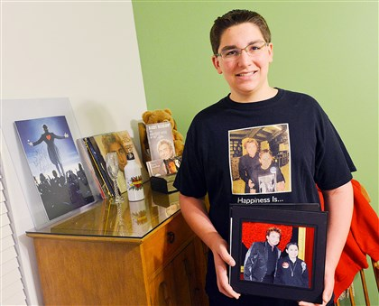 20140728lrwmanilow02-1 Gage Zurcher, a 14-year-old student at West Allegheny High School, poses in his room with photos and memorabilia he received from Barry Manilow.