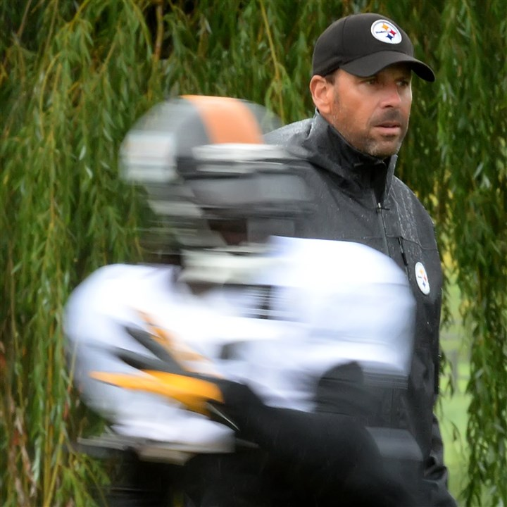 20140728pdSteelersSports01 Steelers offensive coordinator Todd Haley watches receiver drills during afternoon workouts in the rain Monday at Saint Vincent College.