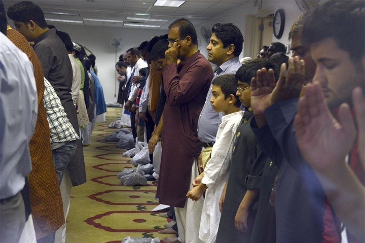 Eid al-Fitr Muslims pray during Eid al-Fitr prayer services at the Muslim Community Center of Greater Pittsburgh.
