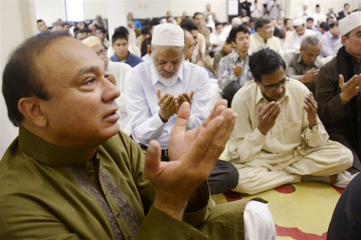 Ramdan in Monroeville Mehboor Ohaudhry of Monroeville, left, lifts his hands in prayer Monday to close services for Eid al-Fitr at the Muslim Community Center of Greater Pittsburgh in Monroeville. The celebration marks the end of fasting during the month of Ramadan.