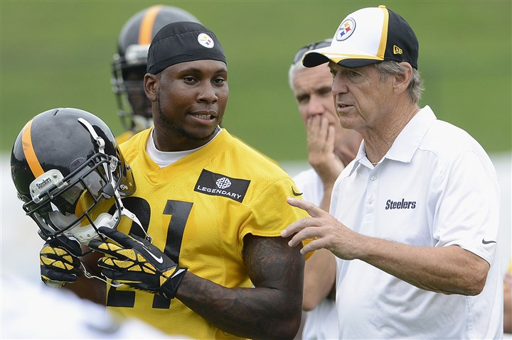 20140727radSteelersCampSpts22-8 Steelers defensive coordinator Dick LeBeau instructs safety Robert Golden on Sunday at training camp in Latrobe.