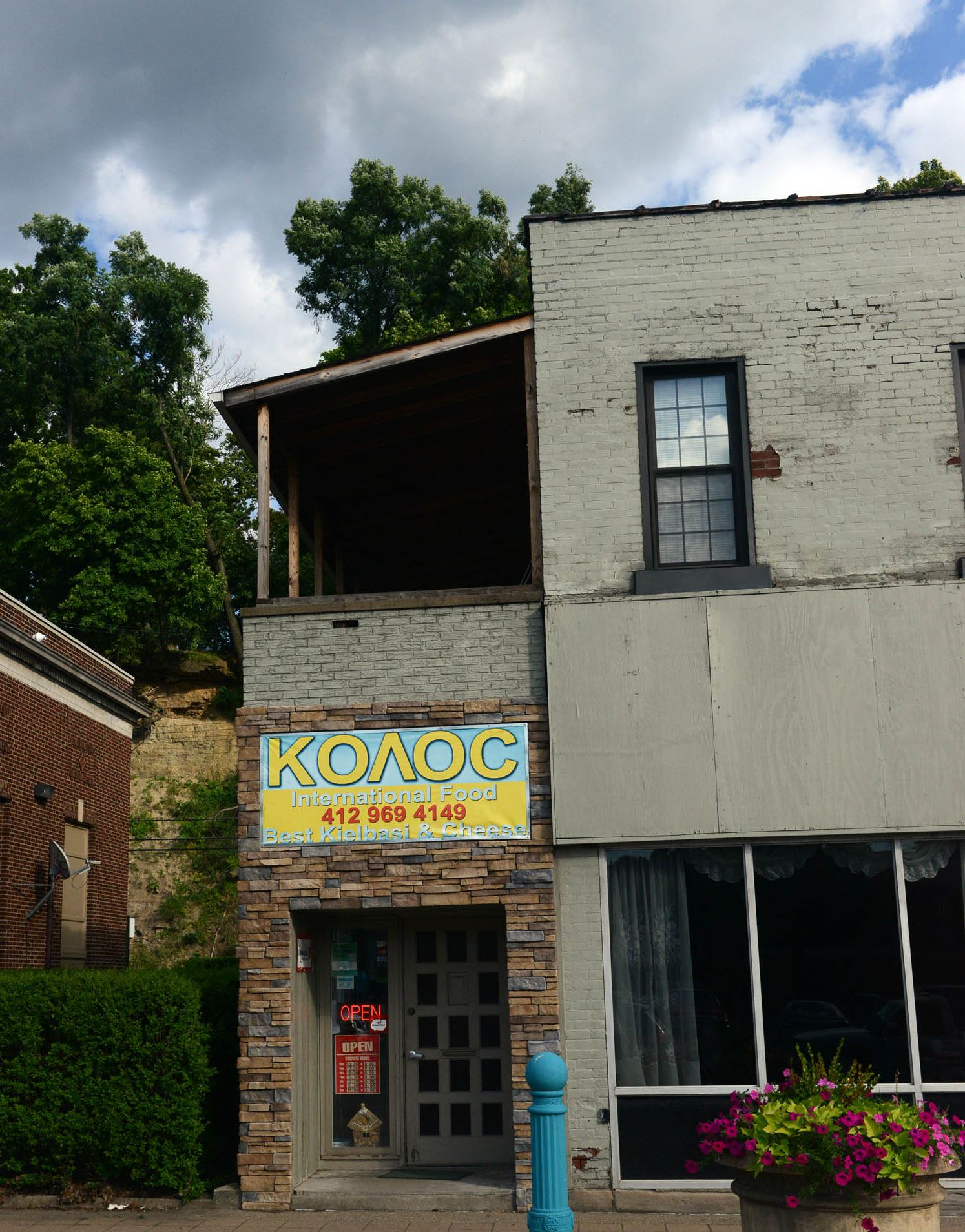 20140724MWHcarnegieFood07-6 The exterior of Kolos International Food on Main Street in Carnegie.