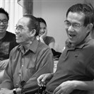 Nghi Nguyen, center, at a meeting with other members of the Vietnamese Catholic community last month in O'Hara.