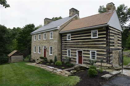 The exterior of the home, showing the log cabin addition.  The exterior of the home, showing the log cabin addition.