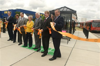 20140729RARlocalstop2-1 Gov. Tom Corbett, Allegheny County Chief Executive Rich Fitzgerald and State Sen. Matt Smith along with other local dignitaries cut the ribbon to the new Super Stop Bus Stop in front of Ikea in Robinson.