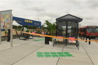 20140729RARlocalstop5-4 The new Super Stop bus stop in front of IKEA in Robinson features tables, benches and a bike repair station. The Airport Corridor Transportation Association created the hub that will serve bus passengers, pedestrians and bicyclists.