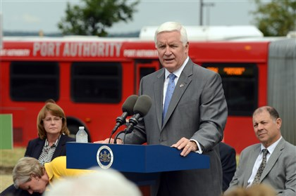 20140729RARlocalstop1 Gov. Tom Corbett speaks during the grand opening of the Super Stop Bus Stop in front of Ikea in Robinson.