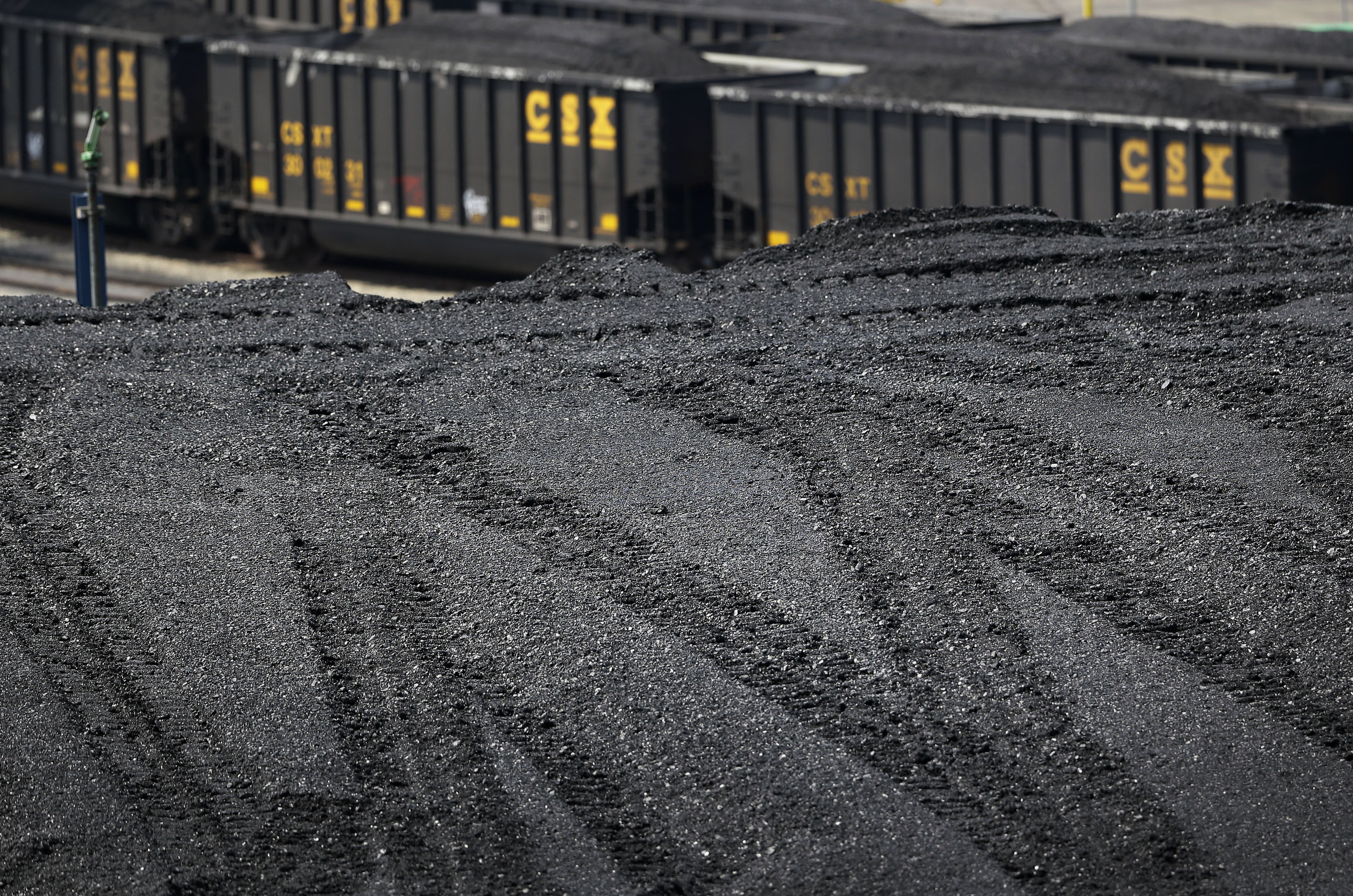 Obama Exporting Pollution In this May 22, 2014, photo, a large pile of coal sits in front of train cars carrying coal at Dominion Terminal Associates' coal terminal in Newport News, Va. Over the last six years, American energy companies have sent more coal than ever before to other parts of the world, in some cases to places with more lax environmental standards. As the Obama administration weans the U.S. off dirty fuels blamed for global warming, energy companies have been sending more of America's unwanted energy leftovers to other parts of the world, where they could create even more pollution.