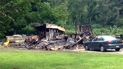 20140730MMexplosion0731loca An explosion leveled a Pleasant Road trailer home Wednesday in Harrison Township.