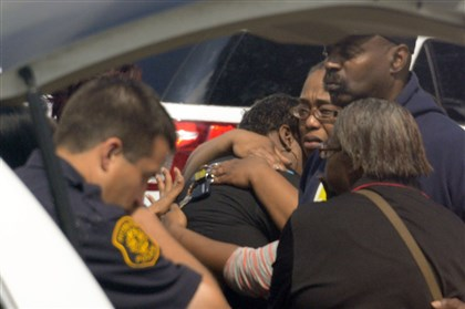 20140730dsNorthviewLocal02-1 People grieve as officals investigate a fatal shooting of a male in Northview Heights.