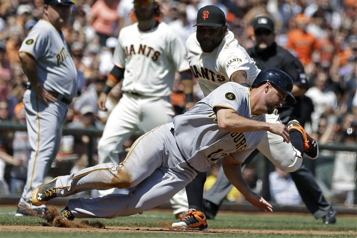 Pirates Giants Baseball The Pirates' Gaby Sanchez, foreground, is tagged out while caught stealing by San Francisco Giants third baseman Pablo Sandoval in the sixth inning of Wednesday's game in San Francisco.