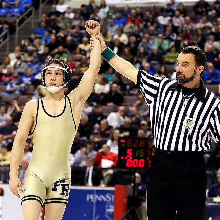 PIAA Wrestling Franklin Regional's Spencer Lee, left, has his hand raised in victory after defeating General McLane's Joe Wheeling during their 113-pound finals match in March in the PIAA wrestling championships in Hershey.