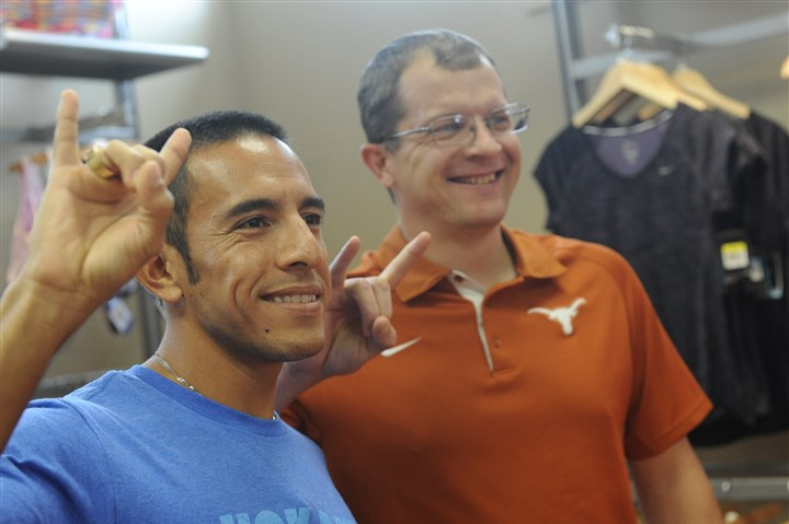 20140730rldLibertyMile02-1 Olympic 2012 silver medalist and University of Texas Leo Manzano, left, of Austin, Texas, poses for a photograph with Jason Kurtz of Bethel Park at the Fleet Feet running store in Bethel Park on Wednesday.