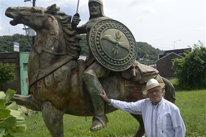 Sam Kiss stands with Sir Samelot Sam Kiss stands with Sir Samelot, a three-ton statue of a warrior on horseback installed on the lot near his home along Seneca Street in the Uptown section of Pittsburgh.