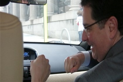 20140801mcLyft02Bus-1 Mayor Bill Peduto fist-bumps his ride-share driver, Brad Hoffman, after getting into Mr. Hoffman's Lyft car.