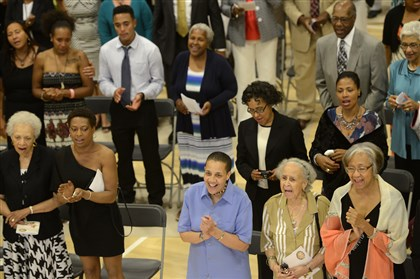 "20140801rldThelmaLovette01 Gail Carter, center, along with her mother Annie Carter, second from right, and Andrea Griffin, right, sing ""This Little Light of Mine,"" during a memorial service for Thelma Lovette on Friday."