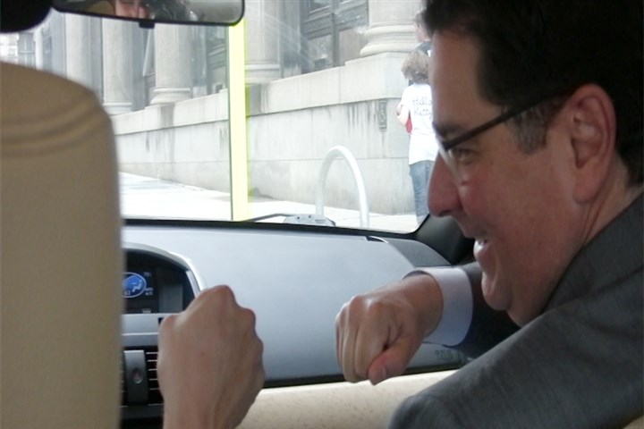 20140801mcLyft02Bus-1 Mayor Bill Peduto fist-bumps his ride-share driver, Brad Hoffman, after getting into Mr. Hoffman's Lyft car Friday.
