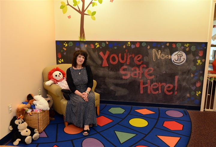 20140730RARseennursery2-1 LouAnn Ross, executive director of Jeremiah's Place, in the reading area.