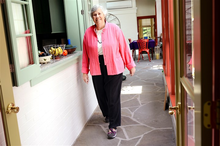 20140731ppVitalsHome2HEALTH-1 Lorraine Roberts of Fox Chapel walks through a breezeway built along the back of her Fox Chapel home to connect the new ground-level addition to the dining room, one of the renovations she and her husband Philip completed to make the home wheel-chair accessible.
