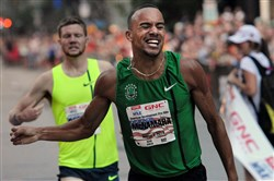 Elite runners race in the Liberty Mile on Aug 1, 2014 in Downtown Pittsburgh. Winner Jordan McNamara, center, was timed at 4:0293 at the finish line on Liberty Ave.