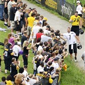 Steelers quaterback Ben Roethlisberger greets fans as he walks to the practice field during last year's training camp in Latrobe.                      Original Filename: 20140727radSteelersCampSpts.1.jpg
