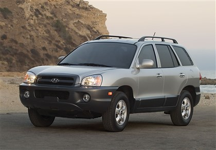 Hyundai Recalls This undated photo provided by Hyundai shows the 2005 Hyundai Santa Fe. Hyundai is recalling more than 419,000 cars and SUVs to fix suspension, brake and oil leak problems. The biggest of three recalls posted Friday, Aug. 1, 2014, by U.S. safety regulators is of 225,000 Santa Fe SUVs from 2001-2006 to replace front coil springs that can rust and crack in cold-weather states. The springs can fracture and make contact with a tire, potentially causing a crash. (AP Photo/Hyundai)