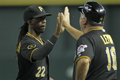 Pirates Diamondbacks Baseball Pirates' Andrew McCutchen is congratulated by third base coach Nick Levya following a 9-4 victory against the Arizona Diamondbacks during a baseball game on Friday in Phoenix.