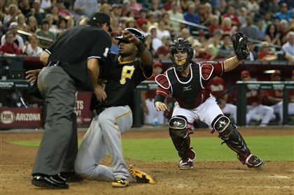 9rm00n4w-1 Diamondbacks catcher Tuffy Gosewisch reacts after tagging out Gregory Polanco at home plate during the eighth inning Sunday at Chase Field in Phoenix.