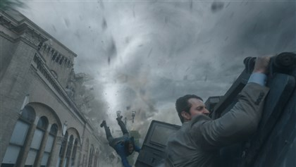 "IntotheStorm5-4 Sarah Wayne Callies as Allison and Richard Armitage as Gary in ""Into the Storm."""