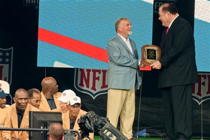 Pittsburgh Post-Gazette pro football writer Ed Bouchette  Pittsburgh Post-Gazette pro football writer Ed Bouchette receives the Dick McCann Award from Pro Football Hall of Fame President and Executive Director Dave Baker, right, during enshrinement ceremonies Saturday night at the Pro Football Hall of Fame in Canton, Ohio.