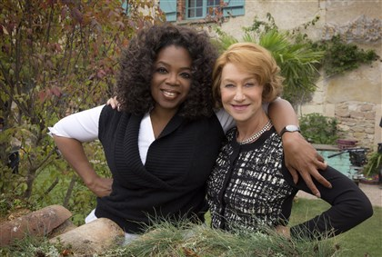 "Hundred3 Academy Award-winner Helen Mirren (right) and producer Oprah Winfrey, on the set of DreamWorks Pictures' ""The Hundred-Foot Journey."" Being filmed on location in the south of France, the motion picture is based on the best-selling novel by Richard C. Morais."