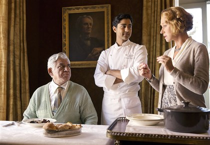 Hundred2-1 Hassan (Manish Dayal, center) serves his father (Om Puri) Beef Bourguinon á la Hassan, a classic French dish with an Indian twist, as Madame Mallory (Helen Mirren) explains its significance to French chefs. ©DreamWorks II Distribution Co., LLC. All Rights Reserved.