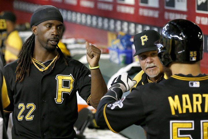 9rm00mmf-1 Andrew McCutchen congratulates teammate Russell Martin, right, after Martin scored a run against the Diamondbacks during the second inning.