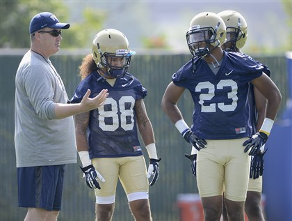 20140804radPittPracticeSpts03-2 Coach Paul Chryst coaches wide receivers Tyler Boyd (23) and Kevin Weatherspoon (88) at the first day of Pitt's preseason practice Monday at their training facility on the South Side.