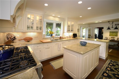The kitchen. The 25- by 13-foot kitchen was remodeled by the homeowners in 2009 and is light, warm and welcoming.