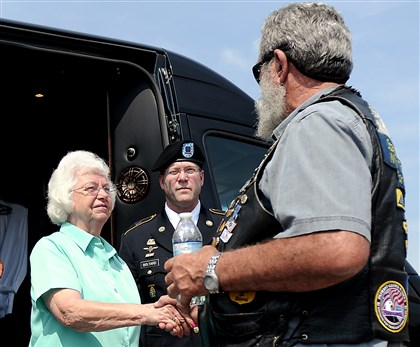 20140805CMPatriotRidersLocal004-3 Lillian Anderson, sister of Alva Groves, shakes hands with Barry Bioni, Pennsylvania State captain of the Patriot Guard Riders, before a procession from Pittsburgh International Airport to Cpl. Groves' final resting place in his hometown of Shinnston, W.Va.