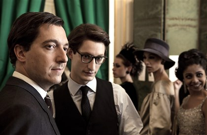 "Yves1 Guillaume Gallienne (as Pierre Berge) and Pierre Niney (as Yves Saint Laurent) star in the movie ""Yves Saint Laurent."""